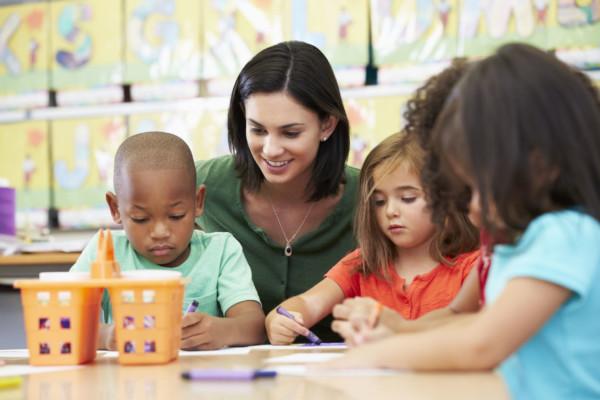Preschool children and teacher coloring